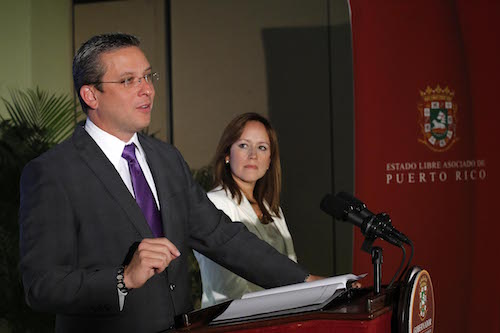 Laura Vélez, EQB's former president, in a press conference with the Governor of Puerto Rico